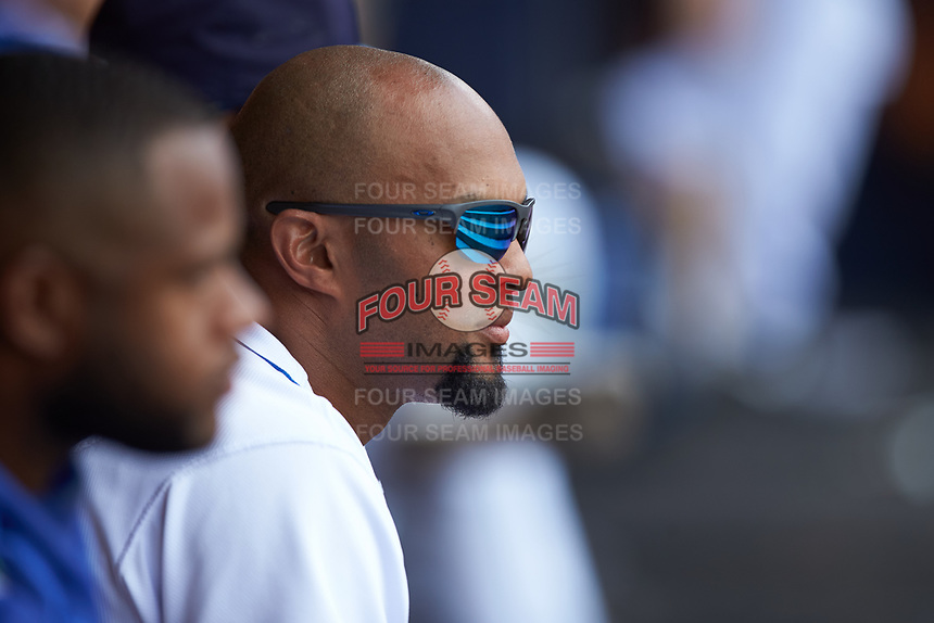 Emilio Bonifacio (22) of the Durham Bulls watches the action from the dugout during the game against the Columbus Clippers at Durham Bulls Athletic Park on June 1, 2019 in Durham, North Carolina. The Bulls defeated the Clippers 11-5 in game one of a doubleheader. (Brian Westerholt/Four Seam Images)