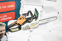 A chainsaw sits atop a stack of papers intended to look the US Tax Code during a campaign event for Kentucky senator and Republican presidential candidate Rand Paul at Kilton Library in West Lebanon, New Hampshire. The top pages had portions of the tax code printed on them, but the rest of the stacks were blank paper. The scene is a reference to a video Rand Paul posted on youtube of himself using a chainsaw to destroy the US Tax Code.