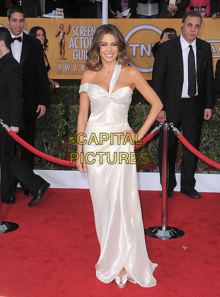 Sofia Vergara (wearing Donna Karan Atelier).Arrivals at the 19th Annual Screen Actors Guild Awards at the Shrine Auditorium in Los Angeles, California, USA..27th January 2013.SAG SAGs full length white hand on hip silk satin one strap off the shoulder .CAP/DVS.©DVS/Capital Pictures.