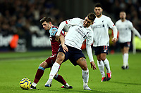 29th January 2020; London Stadium, London, England; English Premier League Football, West Ham United versus Liverpool; Roberto Firmino of Liverpool competes for the ball with Aaron Cresswell of West Ham United
