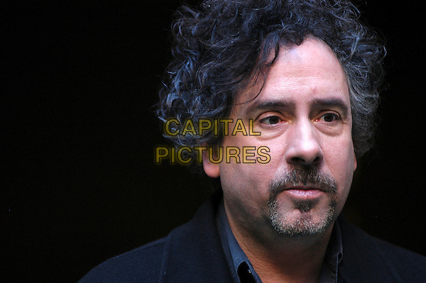 "TIM BURTON.Photocall for ""Sweeney Todd: The Demon Barber Of Fleet Street"", Rome, Italy..January 23rd, 2008.headshot portrait goatee facial hair .CAP/CAV.©Luca Cavallari/Capital Pictures."
