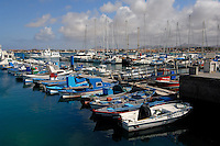Fishing boats and yachts moored to jetty, Corralejo harbour, Fuerteventura, Canary Islands, Spain.
