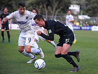 Joel Stevens (Team Wellington) tries to get past Darren White during the Oceania Football Championship final (second leg) football match between Team Wellington and Auckland City FC at David Farrington Park in Wellington, New Zealand on Sunday, 7 May 2017. Photo: Dave Lintott / lintottphoto.co.nz