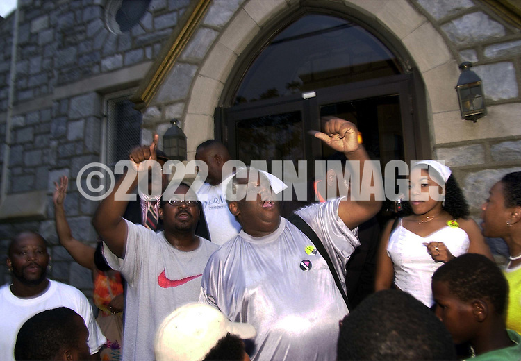 """Protesters chant """"Let Us In!"""", after hundreds turned out at a protest of the July 12 beating of Thomas Jones by city police officers attempting to arrest the carjacking suspect, when they were denied access, because of lack of space in the church Sunday, July 23, 2000, in Philadelphia. The beating incident was videotaped by a local television station helicopter, and broadcast around the world, shedding a bad light on the city of Philadelphia two weeks before the Republican National Convention. (Photo by William Thomas Cain/Newsmakers)"""