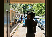 Durham, North Carolina - Fruday July 14, 2017 - Tyron Green, nephew of Laticia Singleton, carries items out of the apartment that Singleton was recently evicted from in Durham.