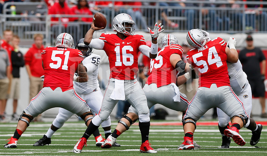 Ohio State Buckeyes quarterback J.T. Barrett (16) is protected by offensive linemen Joel Hale (51), Pat Elflein (65) and Billy Price (54) during Saturday's NCAA Division I football game against the Kent State Golden Flashes at Ohio Stadium in Columbus on September 13, 2014. Ohio State won the game 66-0. (Dispatch Photo by Barbara J. Perenic)