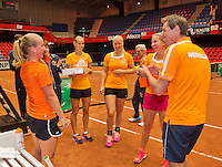 April 16, 2015, Netherlands, Den Bosch, Maaspoort, Fedcup Netherlands-Australia,  Richel Hogenkamp (L) is celebrati&euml;n het birthday with team members: Arantxa Rus, Kiki Bertens, Micha&euml;lla Krajicek an d Captain Paul Haarhuis<br /> Photo: Tennisimages/Henk Koster