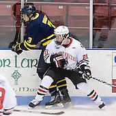 Kyle Bigos (Merrimack - 3), Zak Stone (Northeastern - 21) - The visiting Merrimack College Warriors defeated the Northeastern University Huskies 4-3 (OT) on Friday, February 4, 2011, at Matthews Arena in Boston, Massachusetts.