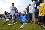 Men and boys at the Islamic Games pray on large blue tarps on the football field at two o'clock when the call to prayer comes over a loud speaker in South Brunswick, New Jersey on May 26, 2007.  Over 600 youths from five states participated in the event.