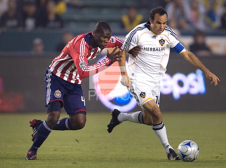 LA Galaxy forward Landon Donovan moves past Chivas USA defender Yamith Cuesta. The LA Galaxy defeated Chivas USA 1-0 and win the playoff series during a MLS Western Conference playoff game at Home Depot Center stadium in Carson, California on Sunday November 1, 2009...