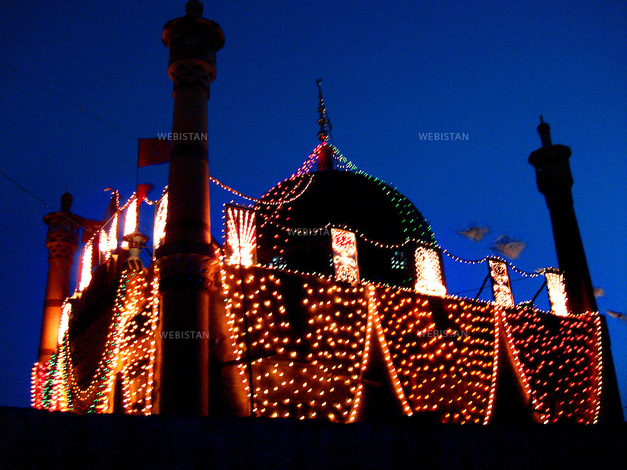SEHWAN SHARIF, PAKISTAN - SEPTEMBER, 2006:  Night view of the shrine of Sekandar Bodla Bahar, one of the main disciples of Lal Shahbaz Qalandar, a 13th century Sufi Master.