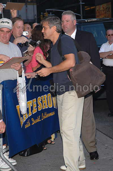 21 September 2005 - New York, New York - George Clooney signs autographs for fans as he arrives for an appearance at the Dave Letterman show in Manhattan.  <br />