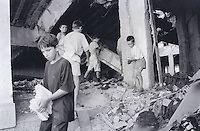 Children scavenge a government building that was destroyed by NATO bombing near Djakovica/Gjakova.