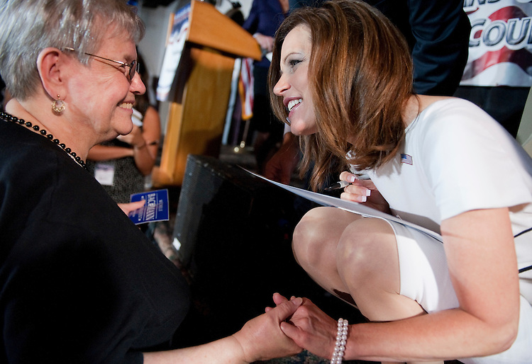 UNITED STATES - AUGUST 14:  Republican presidential candidate Rep. Michele Bachmann, R-Minn., greets an attendee after the Lincoln Day Dinner hosted by the Black Hawk County Republican Party in Waterloo, Iowa.  Candidates Bachmann, Rick Santorum, and Texas Gov. Rick Perry, addressed the gathering.  (Photo By Tom Williams/Roll Call)