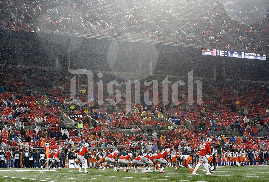 Ohio State Buckeyes quarterback J.T. Barrett (16) waits to hike the ball during a heavy downpour against Illinois Fighting Illini during the 2nd half of their game at Ohio Stadium on November 18, 2017.  [Kyle Robertson / Dispatch]