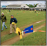 The Super Shoot is the World Series of Benchrest Shooting. More than 300 participants from the United States, Europe, Asia, and Africa compete in this event that is hosted by the Kelbly Family of Ohio. Participants of the Super Shoot strive for the clean hole. A clean hole is five or ten rifle shots buried in exactly the same spot on the target. Even though participants of the Super Shoot strive for the clean hole, in its 54 years of existence the National Bench Rest Shooters Association has never certified a clean hole. It's a quest, as the benchrest shooters always say. Flags and windgauges allow participants of the Super Shoot to understand the patterns of the wind. When the breeze drops participants will fire their shots.