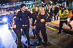 """© Joel Goodman - 07973 332324 . 19/12/2015 . Manchester , UK . Private security detain a man after another man is punched , at Deansgate Locks . Revellers in Manchester enjoy """" Mad Friday """" - also known as """" Black Eye Friday """" - the day on which emergency services in Britain are typically at their busiest , as people head out for parties and drinks to celebrate Christmas . Photo credit : Joel Goodman"""