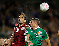 07/09/2015; UEFA Euro 2016 Group D Qualifier - Republic of Ireland v Georgia, Aviva Stadium, Dublin. <br /> Ireland&rsquo;s Jon Walters with Aleksandre Amisulashvili of Georgia.<br /> Picture credit: Tommy Grealy/actionshots.ie.