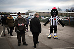 A half-time draw seller and the home club mascot named Victor the Magpie inside the entrance to Victory Park, before Chorley played Altrincham in a Vanarama National League North fixture. Chorley were founded in 1883 and moved into their present ground in 1920. The match was won by the home team by 2-0, watched by an above-average attendance of 1127.