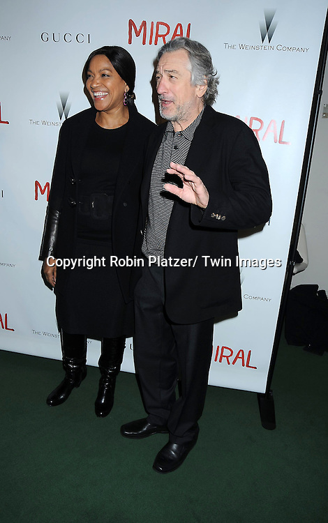 "Grace Hightower and Robert De Niro attending the premiere of"" Miral"" at The United Nations on March 14, 2011 in New York City. Julian Schnabel directed the movie which is from the book by his girlfriend Rula Jebreal."