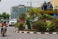 RWANDA, Kigali, city center with banks and insurance companies, roundabout with mountain gorilla statue , behind chinese construction site / RUANDA, Kigali, Stadtzentrum, Banken Buero und Versicherungstower, Berggorilla Skulptur auf Verkehrsinsel