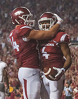 STAFF PHOTO ANTHONY REYES • @NWATONYR<br /> Keon Hatcher (4) Arkansas wide receiver, celebrates a fourth quarter touchdown with Eric Hawkins against Northern Illinois University Saturday, Sept. 20, 2014 at Razorback Stadium in Fayetteville. The Razorbacks won 52-14.