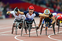 PICTURE BY ALEX BROADWAY /SWPIX.COM - 2012 London Paralympic Games - Day Four - Athletics, Olympic Stadium, Olympic Park, London, England - 02/09/12 - David Weir of Great Britain celebrates as he crosses the line to win the Men's 5000m T54 Final.