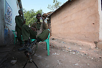 Two Somali Transitional Federal Government  Security Forces rest outside a coffee shop off the main square of the Town of Buur Hakaba, 60 Km east of Baidoa, Somalia on Thursday Dec 28 2006..