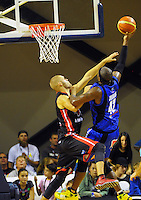 Kareem Johnson lays a shot up during the national basketball league match between Wellington Saints and Canterbury Rams at TSB Bank Arena, Wellington, New Zealand on Monday, 6 April 2015. Photo: Dave Lintott / lintottphoto.co.nz