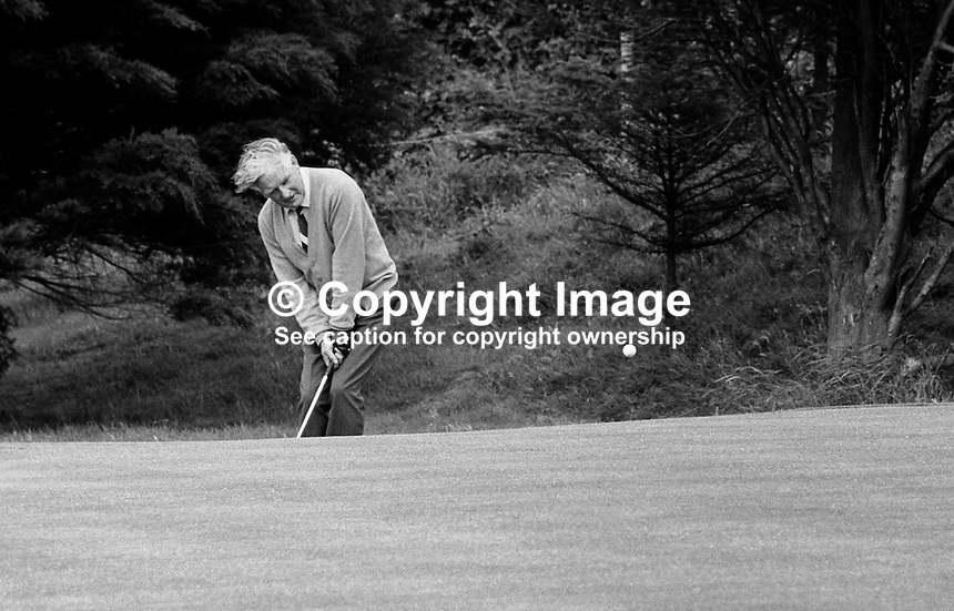 Northern Ireland  golfer, Fred Daly, Belfast, chipping unto a green at Balmoral Golf Club, where he is the professional. July 1969. 196907000197a..Copyright Image from Victor Patterson, 54 Dorchester Park, Belfast, UK, BT9 6RJ..Tel: +44 28 9066 1296.Mob: +44 7802 353836.Voicemail +44 20 8816 7153.Skype: victorpattersonbelfast.Email: victorpatterson@me.com.Email: victorpatterson@ireland.com (back-up)..IMPORTANT: If you wish to use this image or any other of my images please go to www.victorpatterson.com and click on the Terms & Conditions. Then contact me by email or phone with the reference number(s) of the image(s) concerned.