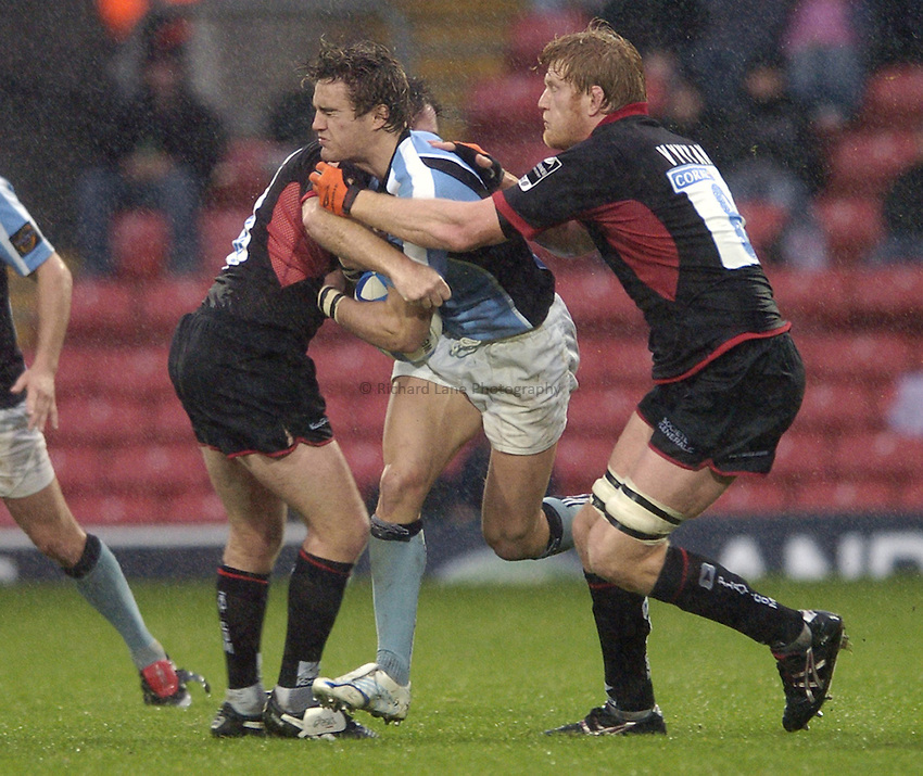 Photo: Jonathan Butler..Saracens v Glasgow Rugby. European Challenge Cup. 22/10/2006..Thom Evans of Glasgow tries to break the tackle of Hugh Vyvyan of Saracens.
