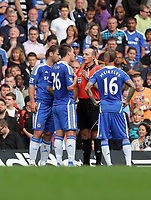 Pictured: John Terry of Chelsea (2ndL) is protesting to referee Mike Dean (3rd L) for the sending off of Fernando Torres for his foul against Mark Gower of Swansea. Saturday 17 September 2011<br />
