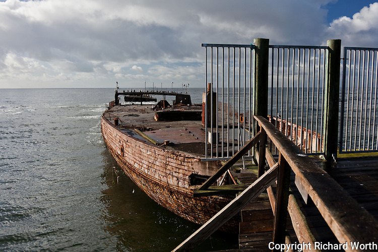 """The California State Parks website sheds light on what is at the end of the fishing pier at Seacliff State Beach:  """"The USS Palo Alto, one of only three cement ships built during World War I, has been a popular attraction for visitors since it was put in place in 1929.""""  More can be found at:   http://www.santacruzstateparks.org/parks/seacliff/    and   http://www.parks.ca.gov/default.asp?page_id=543"""