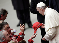 Papa Francesco riceve un cappellino rosso al termine di un'udienza speciale per la Croce Rossa italiana in aula Paolo VI in Vaticano, 27 gennaio 2018.<br /> Pope Francis receives a Red Cross cap at the end of a special audience granted to Italian Red Cross members in Paul VI Hall at the Vatican, on January 27, 2018.<br /> UPDATE IMAGES PRESS/Isabella Bonotto<br /> <br /> STRICTLY ONLY FOR EDITORIAL USE