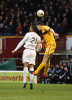 Josh Magennis and Fraser Kerr jump for the ball in the Motherwell v Aberdeen, Clydesdale Bank Scottish Premier League match at Fir Park, Motherwell on 26.12.12.