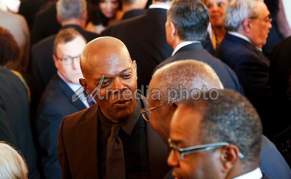 Actor Samuel Jackson speaks with guests during a reception in honor of the opening of the Smithsonian National Museum of African American History and Culture listens, in the Grand Foyer of the White House September 23, 2016, Washington, DC. Photo Credit: Aude Guerrucci/CNP/AdMedia