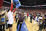 KANSAS CITY, MO - DECEMBER 16: University of Nebraska head coach John Cook is doused with water following the Division I Women's Volleyball Championship held at Sprint Center on December 16, 2017 in Kansas City, Missouri. (Photo by Tim Nwachukwu/NCAA Photos via Getty Images)