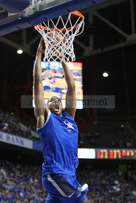 Karl-Anthony Towns dunks the ball during the Blue and White Scrimmage in Rupp Arena in Lexington, Ky., on Monday, October 27,  2014. Photo by Emily Wuetcher | Staff