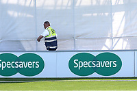 A steward walks in front of the sightscreen and interrupts play during Essex CCC vs Nottinghamshire CCC, Specsavers County Championship Division 1 Cricket at The Cloudfm County Ground on 15th May 2019