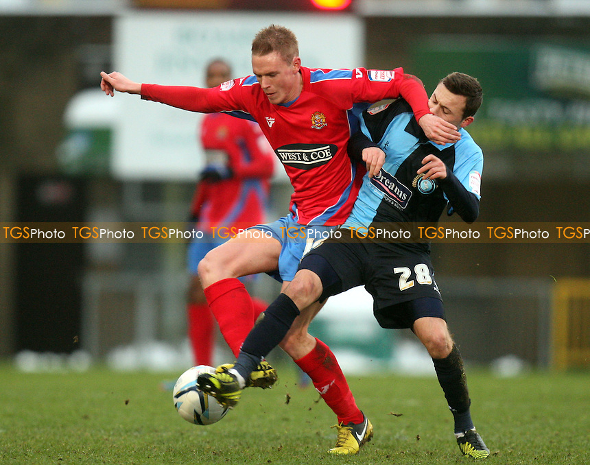 Matthew Saunders of Dagenham and Josh Scowen of Wycombe Wanderers - Wycombe Wanderers vs Dagenham and Redbridge at the Adam Park Stadium - 19/01/13 - MANDATORY CREDIT: Dave Simpson/TGSPHOTO - Self billing applies where appropriate - 0845 094 6026 - contact@tgsphoto.co.uk - NO UNPAID USE.