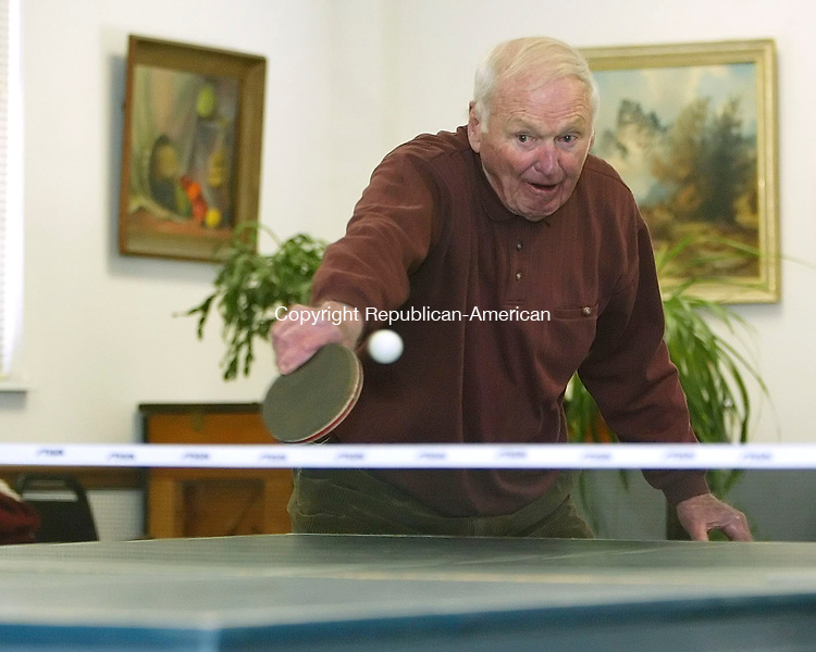 SOUTHBURY, CT, 03/06/07- 030607BZ03- Ed Mayer returns a shot while playing doubles table tennis with friends at the Southbury Senior Center Tuesday afternoon.  The group said they play every Tuesday from 2pm to 4:30pm and welcome new members.<br /> Jamison C. Bazinet Republican-American