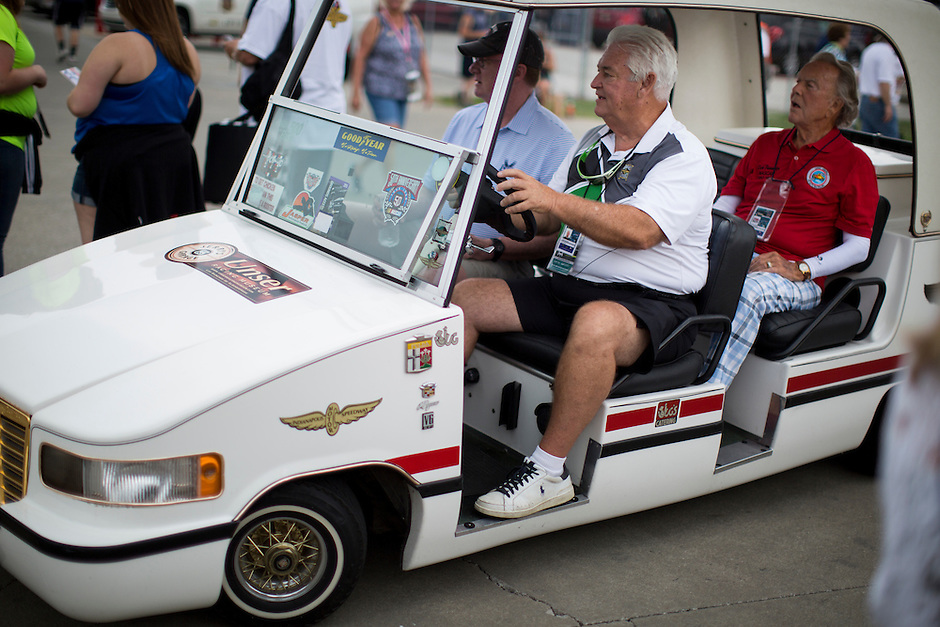 Fans drive through the infield in a Cadillac-styled golf cart before the Brickyard 400 on Sunday, July 26, 2015, at the Indianapolis Motor Speedway. (Photo by James Brosher)