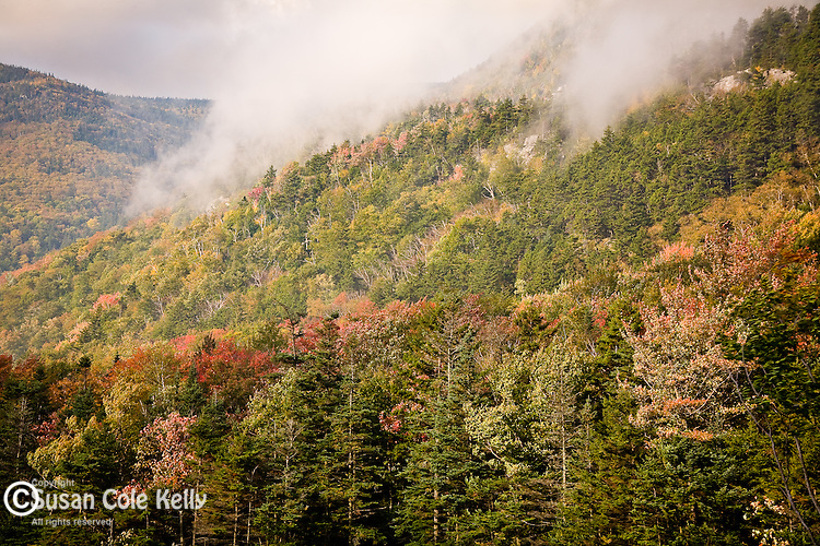 Morning fog streams over Mount Blue in Kinsman Notch, Woodstock, White Mountains, NH, USA