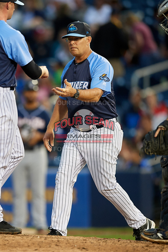 Trenton Thunder manager Jay Bell (11) takes the ball from Matt Frawley (10) as he makes a pitching change during a game against the New Hampshire Fisher Cats on August 19, 2018 at ARM & HAMMER Park in Trenton, New Jersey.  New Hampshire defeated Trenton 12-1.  (Mike Janes/Four Seam Images)