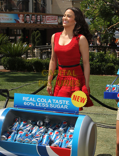 "Paula Patton.Paula Patton Invites Fans To Sample New Pepsi Next For ""Drink It To Believe It"" Campaign Held at The Grove, Los Angeles, California, USA..April 9th, 2012.half length red sleeveless dress black belt smiling funny .CAP/ADM/KB.©Kevan Brooks/AdMedia/Capital Pictures."