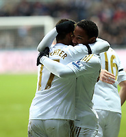 Saturday 19 January 2013<br /> Pictured: Jonathan de Guzman of Swansea (R) celebrating his goal with team mate Itay Shechter (L).<br /> Re: Barclay's Premier League, Swansea City FC v Stoke City at the Liberty Stadium, south Wales.