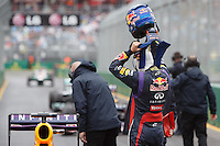 Sebastian Vettel (DEU) from the Infiniti Red Bull Racing team removes his helmet after qualifying first on day four of the 2013 Formula One Rolex Australian Grand Prix at the Albert Park Circuit in Melbourne, Australia.