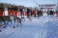Saturday, February 24th, Knik, Alaska.  Jr. Iditarod musher Jeff Holt  leaves start line on Knik Lake