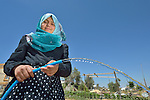Bissan Abudagga, 14, waters her family's small farm with water collected in a rainwater harvesting system her father installed at their home in Al Fukari, Gaza. The family had built a system before, but Israeli air strikes in 2014 destroyed that system and damaged the family's house. With help from Diakonie Katastrophenhilfe, a member of the ACT Alliance, they rebuilt the water system and have repaired some of the damage to their home. In the wake of the devastating 2014 war, ACT Alliance members are supporting health care, vocational training, rehabilitation of housing and water systems, psycho-social care, and other humanitarian actions throughout the besieged Palestinian territory.