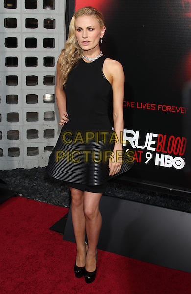 Anna Paquin<br /> &quot;True Blood&quot; Season 6 Los Angeles Premiere held at The Cinerama Dome, Hollywood, California, USA.<br /> June 11th, 2013<br /> full length top dress skirt hand on hip black sleeveless peplum <br /> CAP/ADM/RE<br /> &copy;Russ Elliot/AdMedia/Capital Pictures